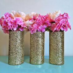 "3 Gold Glitter Glass Cylinder Vases, Wedding Centerpieces, Gold Wedding, Gold Vases. Gold Party Decorations, Gold Birthday, Set of 3. Set of 3 Beautiful Gold Glitter coated Glass Cylinder Vases. The vases in this particular listing are decorated in gold glitter, and sealed to reduce glitter shedding. Flowers and accessories are not included in this order. Specifics/Measurements: Glass Cylinder Vases, approximately 7.5"" tall and 3.25"" diameter. CARE INSTRUCTIONS: Glitter items are NOT..."