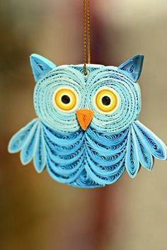 Our handmade Quilled Paper Owl Ornament features a colorful, cute wide-eyed owl. Talented Fair Trade artisans intricately hand-quill paper to create this unique feathered texture on this Owl Christmas ornament.