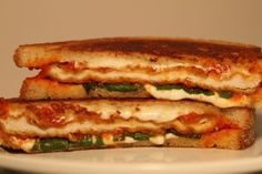 Chicken Parm Grilled Cheese - breaded chicken cutlet, fresh mozzarella, fresh basil, and tomato sauce, on White.