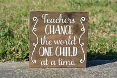 Teacher Gift, Teachers change the world one child at a time, Teacher decor, Classroom Decor, teacher sign, teacher gift  This simple sign makes a great teacher gift. The sign is made from solid wood with a stained background and white vinyl letters. Each piece is made to order so there will be slight variations in the final appearance. Sales tax will be charged to customers from Texas.