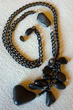 Cascading black nuggets and beads highlight this by Jholei246
