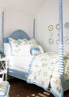 One of the most difficult task in designing a family home is decorating a child's room so they really like and enjoy their own space. The country decor accented in soft hues of blue and pink accents with a hand painted poster bed provides an inviting sense of comforting appeal to any child's space @ bhg.com