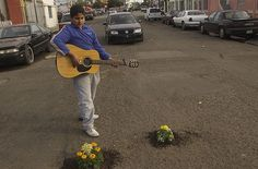 Neighborhood kid in Colonia Federal serenading two marigold pothole gardens