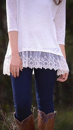 White quarter length shirt with lace.