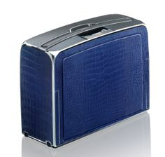HENK - Blue crocodile travel case.  The most state-of-the-art and expensive luggage brand in the world, the HENK is the Bentley of the modern day carrying case for the elite business traveller. Or more fittingly it's the Boeing Business 747 Private Jet. Both involve business, travel and luxury, and the HENK even boasts some of the same features asaircrafttechnology.