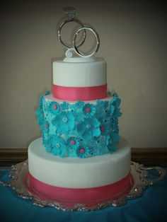 Wedding Cake. So interesting and modern. Love the use of the bright colours, and the rings on top are an interesting touch. We love it! What do you think?!