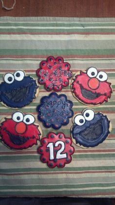 "Elmo and Cookie monster cookies - red and blue acent cookies with ""Happy Birthday"", name, & age"