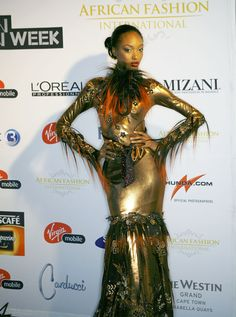 Gold and orage set the tone for a glamourous event. Jourdan Dunn, Cape Town, World Of Fashion, African Fashion, Fashion Forward, Wonder Woman, Glamour, Couture, Superhero