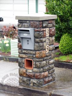 Nice mailbox that can be locked to prevent mail theft.  Things to consider:  mailbox flag, outgoing mail, small package delivery?  #Cultured Stone Mailbox. www.tigerstoneandbrick.com