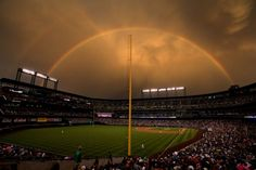double rainbow over Colorado Rockies baseball stadium