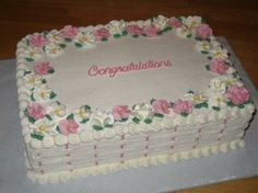 2 layer floral celebration sheet cake with basket weave
