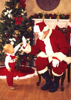 My boy took the cutest Santa picture even though he didn't want to sit on Santa's lap;)