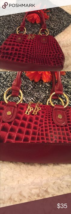 Bolzano Red Croc Handbag Beautiful Croc style Handbag from Bolzano. Red in color and cowhide bottom. Gold metal accents. Zipper closure. Inside has one zipper pocket. Handle drop is 5.50 inches. In excellent condition no shoulder strap. Bolzano Bags Satchels