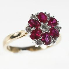 A beautiful ruby and diamond ring in the design of a flower with the rubies creating the petals. The rubies and diamonds have been set in 18ct white and yellow gold. The total weight of the rubies is 1.09ct and the total weight of the diamonds is 0.14ct.