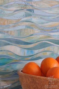Oasis Mosaic backsplash in Peacock Topaz and Aquamarine Jewel Glass by New Ravenna Mosaics