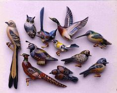 a collection of takahashi bird brooch, wooden, carved, hand painted