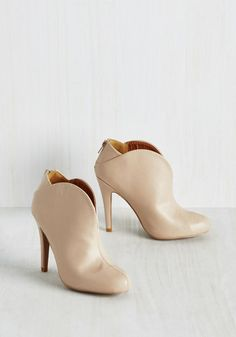 From the moment you try on these neutral pumps, they'll become your new favorite heel! From their curving silhouette to the sultry V-shaped detail on each ankle, these vivacious, vegan faux-leather booties get a gold star for sizzlin' style.