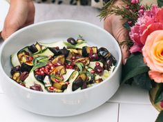 A delicious roasted eggplant salad topped with jewel-like pomegranate, olives and mint