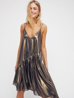 Electra Slip   Sheer slip with an ultra cool, glam look featuring a shiny metallic finish and an effortless, shapeless fit.    * Strappy back * V-neckline * Asymmetrical detail