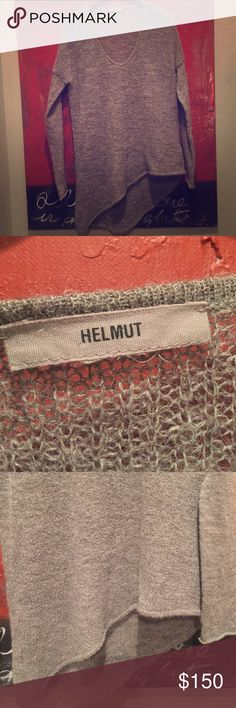 Helmut Lang sweater Helmut Lang grey asymmetrical wool sweater. Dry clean only. This sweater is so well made and stunning on.  It's just too big for me. Only worn once so in excellent condition. Helmut Lang Sweaters V-Necks