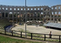 PRETTY. The town centre is dotted with Roman ruins, the most impressive of which is the spectacular Roman amphitheatre.Try to catch an open-air performance there in the busy summer season.