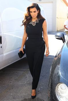 Kim Kardashian Slacks - Kim Kardashian completed her all-black outfit with a pair of tapered black slacks.