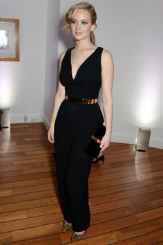 Jennifer Lawrence wore a Christian Dior Couture spring/summer 2014 black silk jumpsuit with a gold metal Dior belt, Brian Atwood heels and a Roger Vivier clutch.