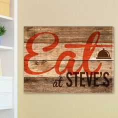 Customized Wood Restaurant Sign Canvas Print  This rustic canvas print brings a touch of traditional charm to your home.   It features an attractive wood texture background with a painted dinner bell icon and personalized message.   The perfect addition to country and western decor, it would also make a great house warming gift.  SIZE:&...