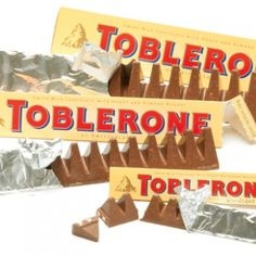 Classic Milk Chocolate with Honey and Almond Nougat : Toblerones    Pelican Dairy & Food LLC introducing Toblerone's New Milk Chocolate Minis Bag. Individually wrapped pieces  of our classic Milk Chocolate with Honey and Almond Nougat.