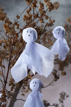 Dress your house to impress this Halloween with a spooky ghost tree, if you've not got a branch handy then why not hang the ghosts in windows or cupboards.