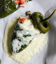 cheese smothered stuffed poblanos