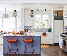 Love this kitchen!  Blue island, dark floors, white cupboards and walls, black touches. :)