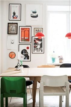 I love the mix-and-matched chairs, the bold prints on the wall, the colorful lampshades.