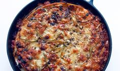 Lamb, peppers and tortilla baked in a round skillet