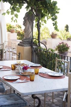 At Casa Cusceni in #Sicily, you can enjoy breakfast overlooking the villa's terraced gardens, with their wisteria-draped pergolas and views of Mount Etna and the Ionian Sea. Photo by Annie Schlechter.