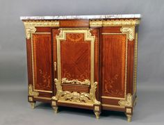 A Rare and Palatial Late 19th Century Gilt Bronze Mounted Louis XVI Style Marquetry and Parquetry Cabinet