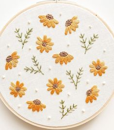 Beautiful, contemporary embroidered florals stitched by @seedandbloomco For more embroidery inspiration, visit DMC.com to see our hundreds of FREE patterns. Crochet Leaf Patterns, Diy Embroidery Patterns, Hand Embroidery Projects, Crochet Leaves, Lace Patterns, Contemporary Embroidery, Modern Embroidery, Embroidery Hoop Art, Cross Stitch Embroidery