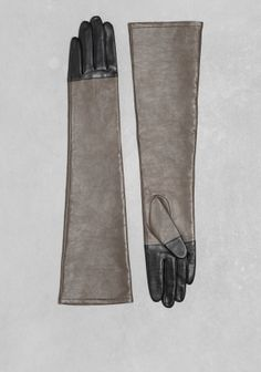 Made from buttery leather, these gloves have a classic look with an elegant to-the-elbow length.