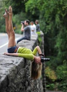 """I've climbed trees to get """"the shot"""" but I don't think I'll ever hang over a bridge like that haha. More power to her."""