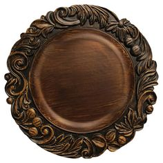 Charger plate with a scrollwork rim and distressed brown finish.