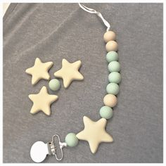 Mint, cream, pacifier clip, teether star and beads, silicone pacifier clip.