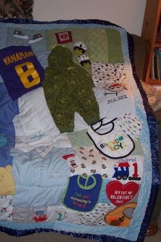 a quilt made up of their baby clothes; i am IN LOVE with this idea! baby boy clothes quilt by krickyskreations on Etsy, $175.00