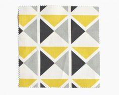 Triangle pattern on textile in yellow, grey, and black by Mademoiselle Dimanche