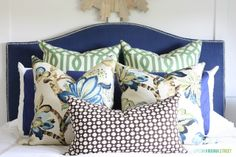 Pillows: from front to back are: 12x24 Schumacher Celerie Kemble Betwixt in Bear; 22x22 Schumacher Kelmscott Manor; Blue and Cream Stripe Body Pillow Cover and Pillow - Target Room Essentials; 26x26 Schumacher Kelly Wearstler Imperial Trellis. All sewn by me {with the exception of the Target pillow.