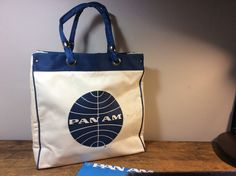 A personal favorite from my Etsy shop https://www.etsy.com/listing/529079467/vintage-pan-am-tote-white-with-blue