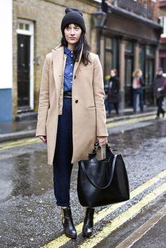 Beige coat, blue shirt, black pants