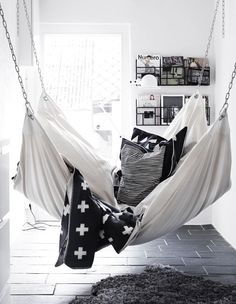 I love this idea for an indoor hammock in a sunroom