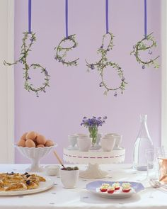 This shower theme was inspired by the French countryside in summer, where the fields are carpeted in lavender and the sky is nursery blue.Above the buffet, wire letters were decorated with oregano and forget-me-nots.