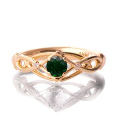 Braided Engagement Ring Emerald and Diamond engagement ring