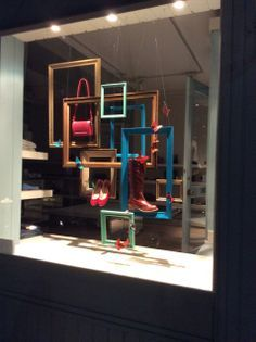love the use of frames to display products in the window!